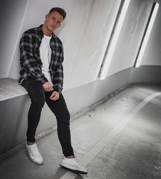 White and Red Leather Low Top Sneakers Outfits For Men: One of the most popular ways for a man to style a charcoal plaid flannel long sleeve shirt is to wear it with black skinny jeans in a relaxed combo. Take a more refined approach with footwear and add white and red leather low top sneakers to the equation.