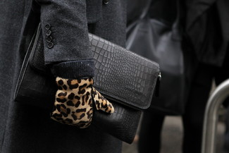 How to wear: charcoal overcoat, black leather zip pouch, tan leopard suede gloves