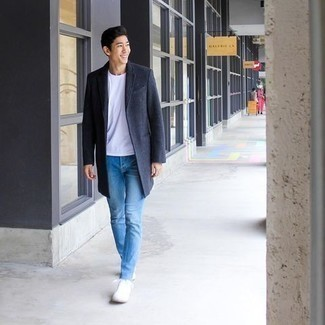 Charcoal Overcoat Outfits: Pair a charcoal overcoat with light blue skinny jeans for a casually edgy and stylish ensemble. You can get a little creative with footwear and dress down this look by slipping into a pair of white canvas low top sneakers.