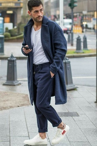 How to Wear a Charcoal Overcoat: When the situation permits relaxed styling, wear a charcoal overcoat and navy sweatpants. Wondering how to round off? Complete your getup with a pair of white low top sneakers for a more laid-back take.