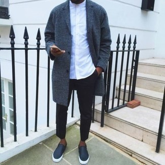 1200+ Cold Weather Outfits For Men: Pair a charcoal overcoat with black chinos to be the picture of rugged sophistication. To bring out a more laid-back side of you, complement this ensemble with navy leather slip-on sneakers.