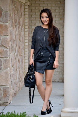 Pair a charcoal knit oversized sweater with a black leather mini skirt for a comfy-casual look. Take a classic approach with the footwear and opt for a pair of black leather pumps.