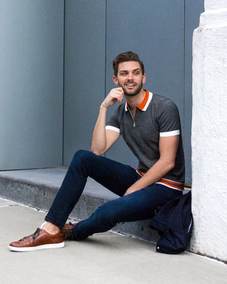 How to wear: charcoal polo, navy skinny jeans, brown leather low top sneakers