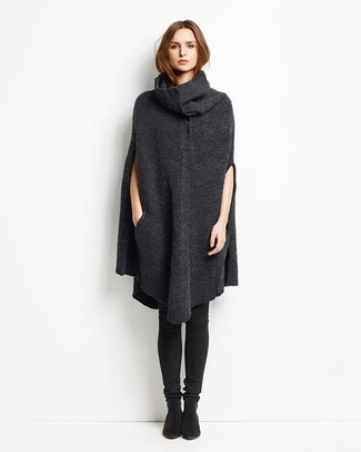 For an ensemble that brings functionality and chicness, dress in a charcoal poncho. Black suede over the knee boots tie the getup together.