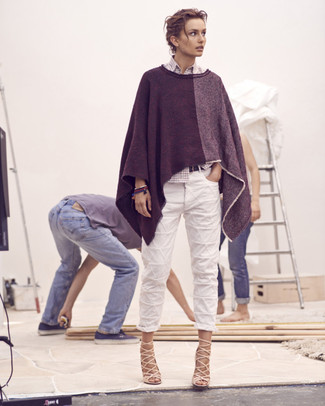 If you feel more confident in comfy clothes, you'll fall in love with this absolutely chic pairing of a charcoal poncho and white boyfriend jeans. Add a sultry vibe to your outfit by rocking beige leather heeled sandals.