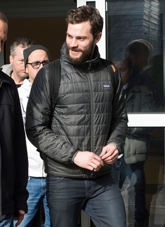 Jamie Dornan wearing Charcoal Puffer Jacket, Charcoal Jeans, Black Canvas Backpack