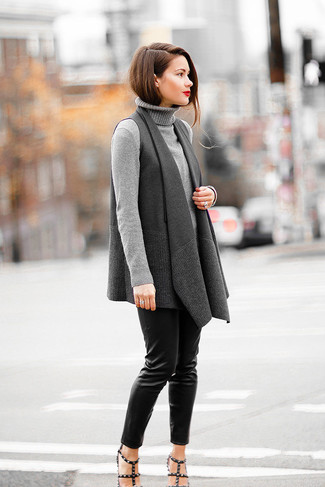 How to wear: charcoal sleeveless coat, grey turtleneck, black leather skinny pants, black studded leather heeled sandals