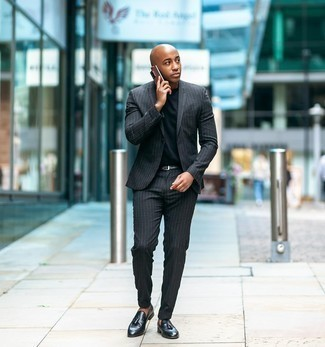 Black Crew-neck T-shirt Outfits For Men: Team a black crew-neck t-shirt with a charcoal vertical striped suit for a sleek elegant outfit. Up this ensemble with black leather tassel loafers.