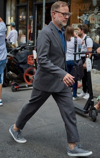 How to Wear Grey Canvas Low Top Sneakers For Men: This combo of a charcoal suit and a blue denim shirt is a goofproof option when you need to look like a proper gentleman. You can take a more laid-back approach with footwear and slip into grey canvas low top sneakers.