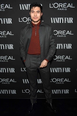 How to Wear a Red Polo Neck Sweater For Men: This sophisticated combo of a red polo neck sweater and a charcoal suit will prove your sartorial savvy. Feeling transgressive? Dial down this look by rocking a pair of black leather chelsea boots.