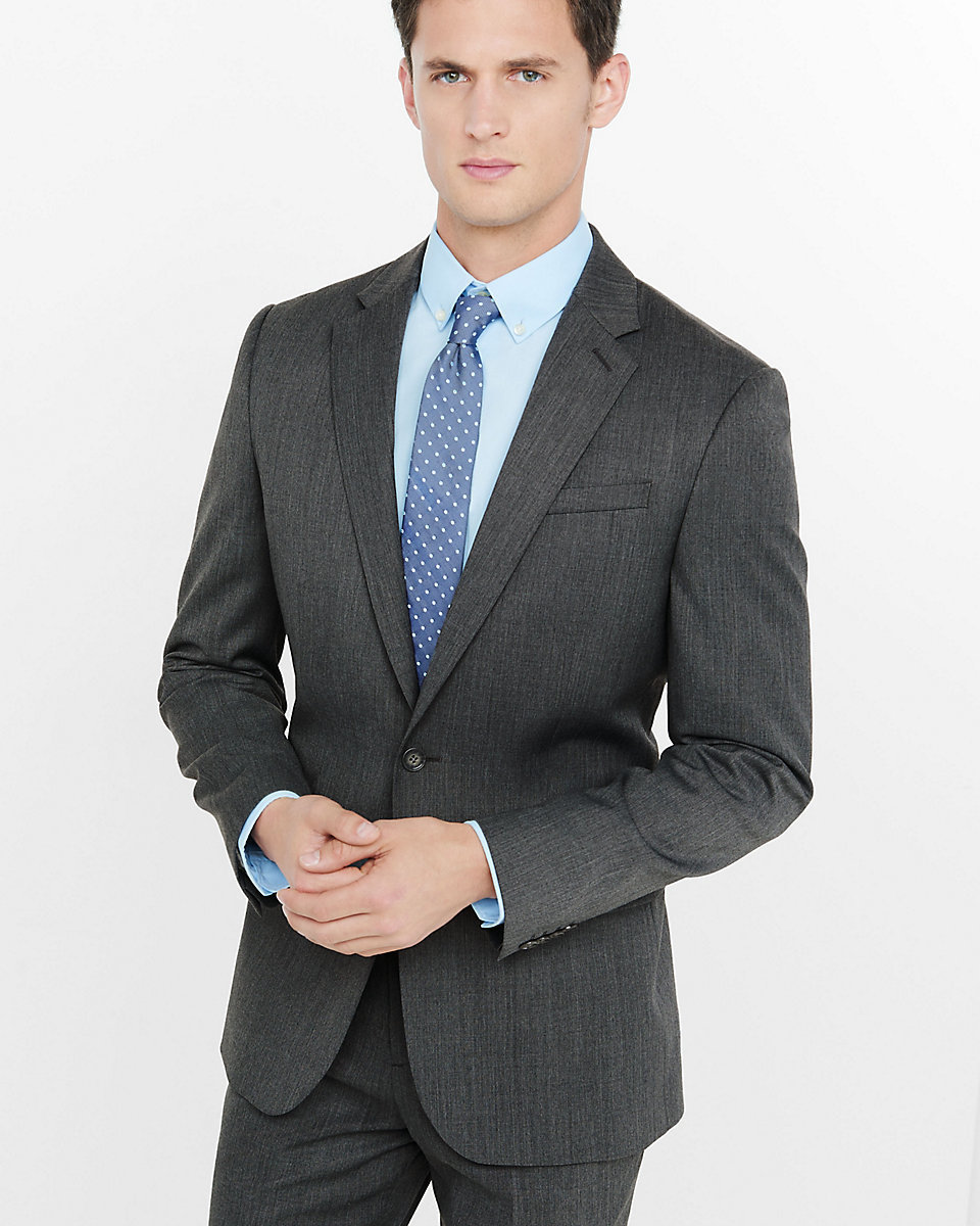 dark grey suit blue shirt