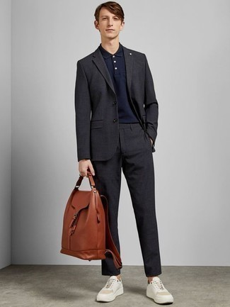 Tobacco Leather Backpack Outfits For Men: For an outfit that's super simple but can be manipulated in a multitude of different ways, wear a charcoal suit and a tobacco leather backpack. When it comes to shoes, complement this look with a pair of white leather low top sneakers.