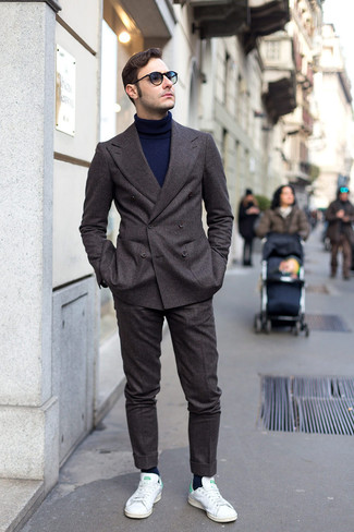 White and Green Low Top Sneakers Outfits For Men: Look your best in a charcoal wool suit and a navy turtleneck. Got bored with this look? Enter white and green low top sneakers to switch things up.