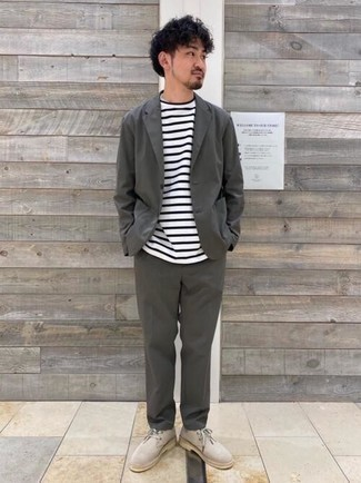 Charcoal Suit Outfits In Their 30s: This combo of a charcoal suit and a white and black horizontal striped crew-neck t-shirt is a foolproof option when you need to look dapper in a flash. Complete this getup with a pair of beige suede desert boots to give a touch of stylish effortlessness to this ensemble. As a 30-something man, you want to start dressing like an adult man. If that's the case, ensembles like this are perfect as inspiration.