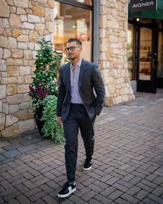 How to wear: charcoal wool suit, white and purple vertical striped dress shirt, black and white leather low top sneakers, grey socks