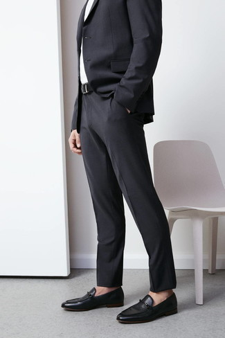 How to Wear a Suit: For a look that's elegant and wow-worthy, team a suit with a white dress shirt. And if you need to instantly tone down this look with shoes, why not slip into black leather loafers?