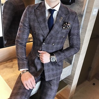 How to Wear a Black Print Pocket Square: The best choice for laid-back style? A charcoal plaid wool suit with a black print pocket square.