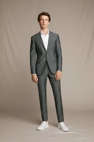 Charcoal Suit Outfits: Teaming a charcoal suit and a white dress shirt is a fail-safe way to infuse personality into your styling arsenal. A pair of white leather low top sneakers brings just the right amount of visual interest to this ensemble.