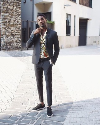 How To Wear a Long Sleeve Shirt With a Suit: This polished combination of a suit and a long sleeve shirt is truly a statement-maker. Jazz up this ensemble by slipping into a pair of charcoal suede low top sneakers.