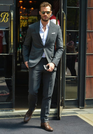 Jamie Dornan wearing Charcoal Suit, White Long Sleeve Shirt, Dark Brown Leather Derby Shoes, White Pocket Square