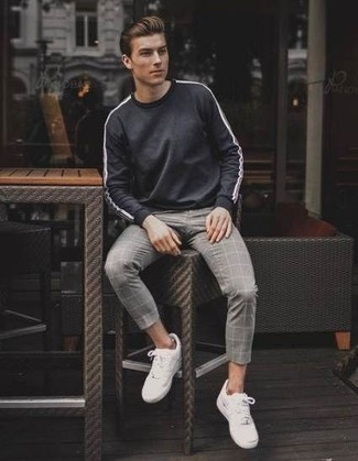How to Wear a Grey Sweatshirt For Men: This relaxed casual combo of a grey sweatshirt and grey check chinos is super easy to put together in next to no time, helping you look amazing and ready for anything without spending a ton of time rummaging through your wardrobe. Complete your look with a pair of white low top sneakers for maximum impact.