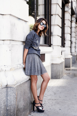 How to wear: charcoal print sweatshirt, grey skater skirt, black embroidered suede heeled sandals, silver sunglasses