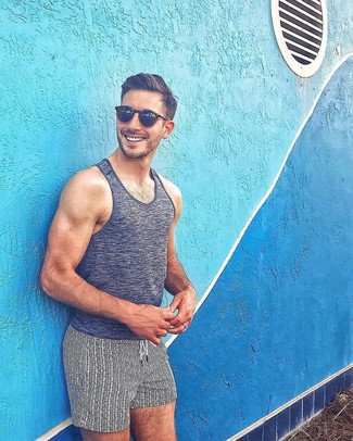 How to wear: charcoal tank, white and black print swim shorts, black sunglasses