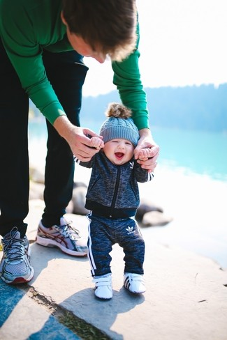 Consider dressing your child in a charcoal track suit for a laid-back yet fashion-forward outfit. And why not add white sneakers to the mix?