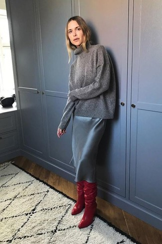 A charcoal turtleneck looks especially elegant when paired with a skirt. Red leather over the knee boots work spectacularly well here. So when summer is over and autumn is settling in, you'll find this getup to be your everything.