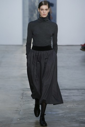 How to wear: charcoal turtleneck, charcoal pleated midi skirt, black leather lace-up flat boots, black tights
