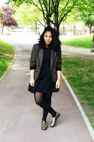 How to Wear a Charcoal Tweed Jacket For Women: Get into zen mode in this comfy combo of a charcoal tweed jacket and a black skater dress. Gold leather oxford shoes are a nice choice to complete your ensemble.