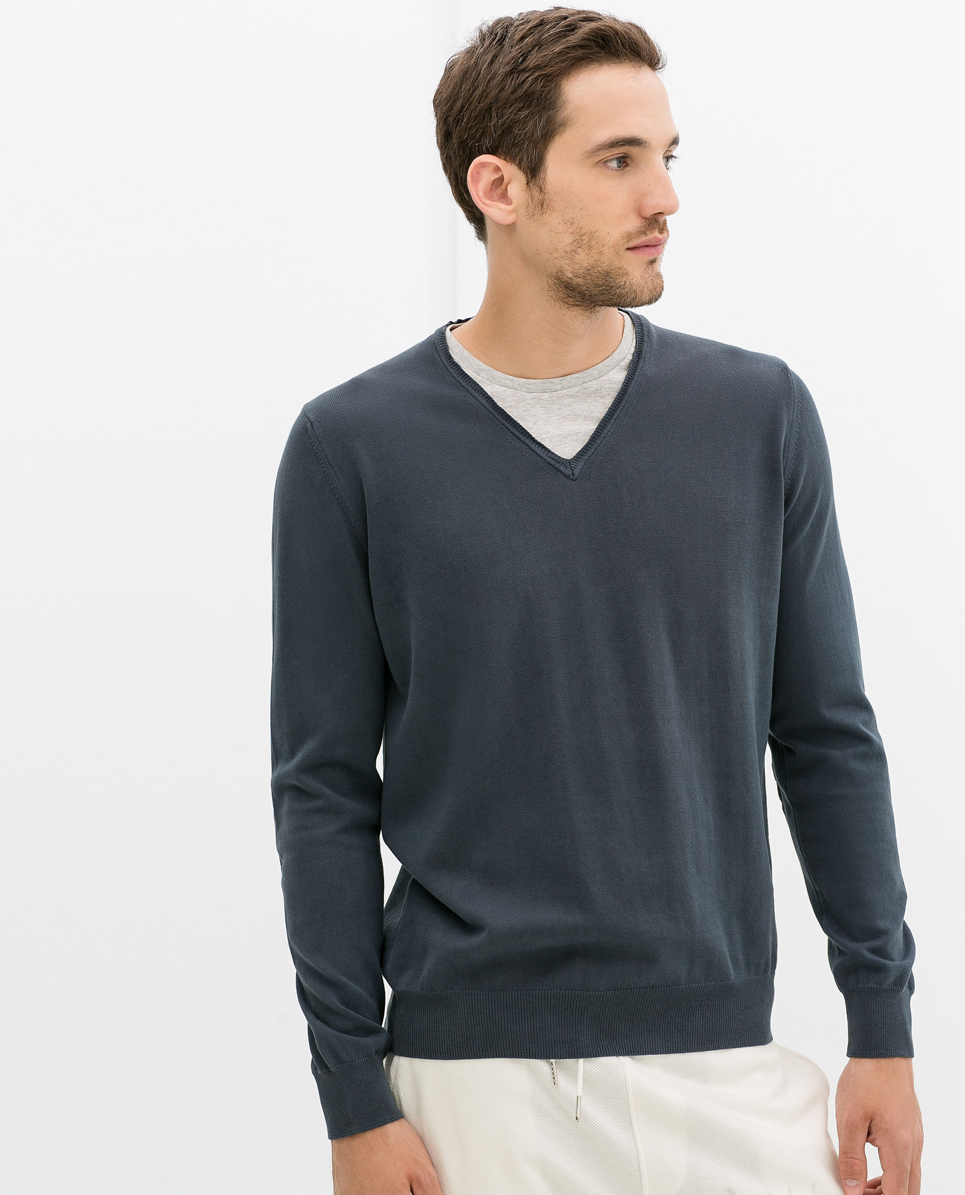 grey and white sweater baggage clothing