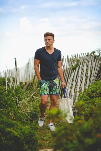 Marry a charcoal v-neck t-shirt with navy floral shorts if you're looking for an outfit idea for when you want to look casually cool. And it's a wonder what a pair of white plimsolls can do for the look. This combination is a safe option if you're on the lookout for a great, summer-friendly outfit.