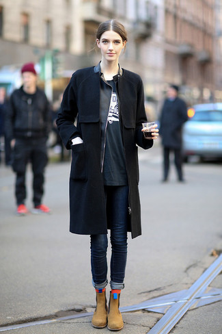 How to wear: black coat, black leather biker jacket, black and white print crew-neck t-shirt, navy skinny jeans