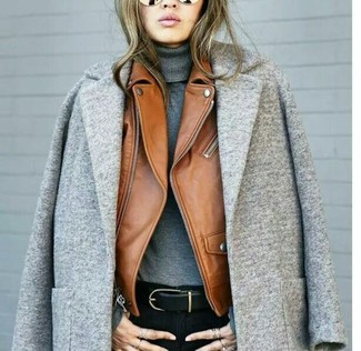 How to wear: grey coat, tobacco leather biker jacket, grey turtleneck, black skinny jeans
