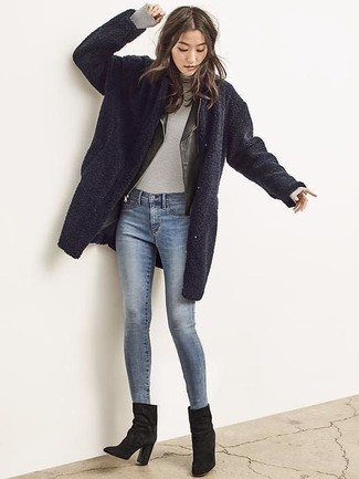How to wear: navy fleece coat, black leather biker jacket, grey turtleneck, blue skinny jeans