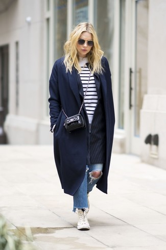 How to wear: navy coat, black vertical striped blazer, white and black horizontal striped crew-neck sweater, blue ripped jeans
