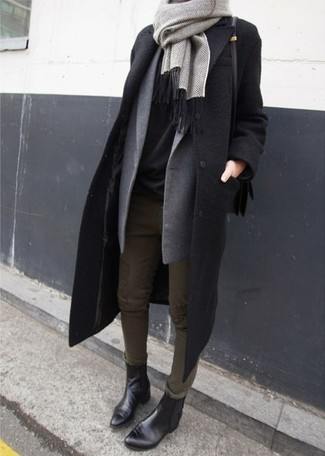 This combination of a black coat and olive slim jeans spells comfort and definitely sass. For footwear go down the casual route with black leather chelsea boots. As you can see, this combination proves that good style and dressing warmly for the winter season are not mutually exclusive.