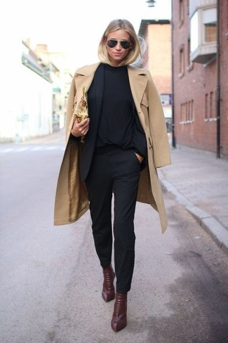 Dress to impress in a black long sleeve t-shirt and black fitted pants. For the maximum chicness throw in a pair of dark red leather ankle boots.