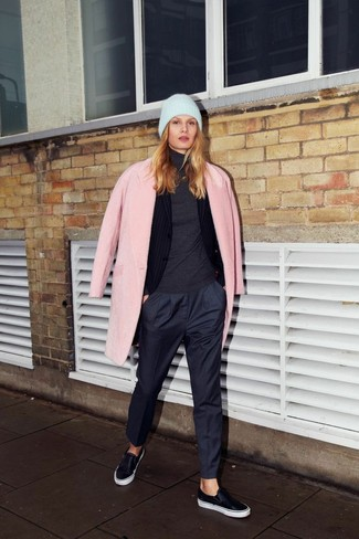 Consider pairing a rose pink coat with navy trousers for a seriously stylish look. Black leather slip-on sneakers will add some edge to an otherwise classic look.