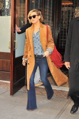 How to wear: camel corduroy coat, light blue print button down blouse, navy flare jeans, red fringe suede crossbody bag