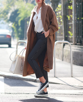 How to wear: brown coat, white button down blouse, black and white vertical striped skinny pants, black and white canvas low top sneakers