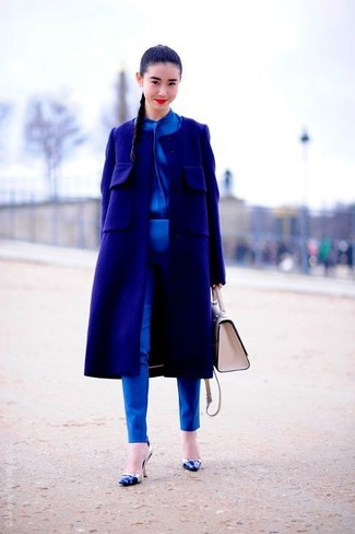 How to wear: navy coat, blue silk button down blouse, blue skinny pants, blue leather pumps