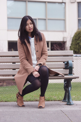 Pair a tan coat with a black mini skirt for a glam and trendy getup. Add brown leather booties to your ensemble for an instant style upgrade. When it's one of those dreary autumn days, sometimes only a kick-ass look like this one can spice it up.