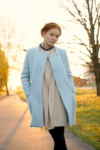 Master the effortlessly chic look in a baby blue coat and black jeans.