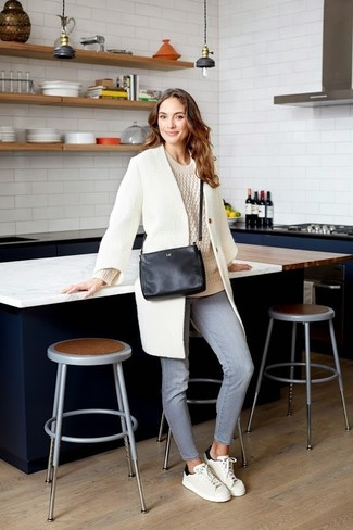 How to wear: white coat, beige cable sweater, grey jeans, white and black leather low top sneakers