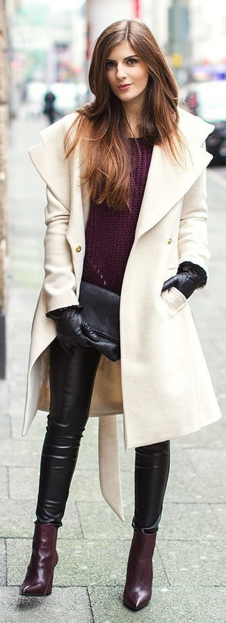 A beige coat and black leather slim pants are a nice combination that will earn you the proper amount of attention. Dark purple leather ankle boots are a nice choice to complete the look.