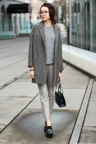 Women's Looks & Outfits: What To Wear In 2020: A grey coat and grey tapered pants paired together are such a dreamy combo for fashionistas who prefer cool chic styles. A pair of black leather ankle boots is a goofproof footwear option here that's also full of character.