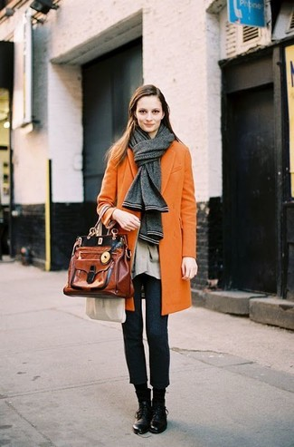 Pair an orange coat with charcoal wool suit pants to feel confidently and look fashionably. Want to go easy on the shoe front? Go for a pair of black leather flat boots for the day. Rest assured, this look will keep you comfortable as well as looking chic in this awkward fall weather.
