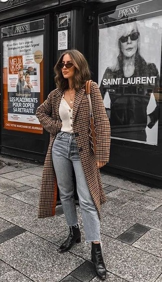 How to wear: brown check coat, white cardigan, grey jeans, black leather ankle boots